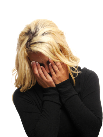 blond haired: A blond haired woman is crying. Stock Photo