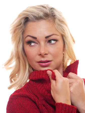 looking away from camera: A attractive blond woman is looking away from the camera. Stock Photo