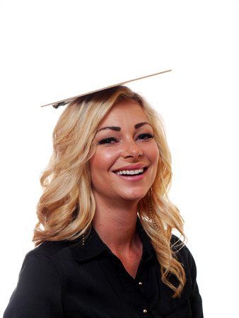 clowning: A attractive blond haired business woman is clowning around with a clipboard on top of her head.