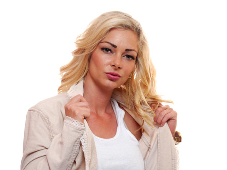 looking into: A attractive caucasian blond woman is looking into the camera.