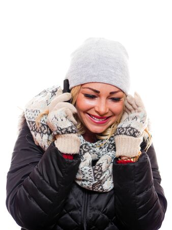 Beautiful woman dressed for winter on the phone.