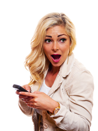 A attractive woman is texting on her cell phone Stock Photo