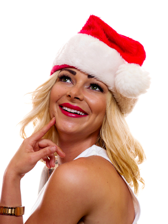 A attractive woman is wearing a Christmas cap.
