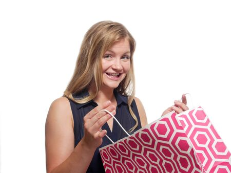 Attractive woman with shopping bag.