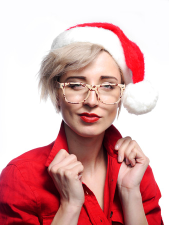 A attractive woman is wearing a Christmas cap and glasses.