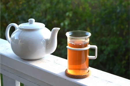 verandah: Tea Pot and Cup of Tea on Luxury Verandah Porch
