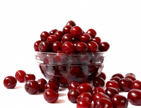 transparent bowl with ripe and delicious cherries, sweet summer fruits  Banque d'images