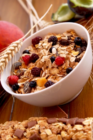 bowl of muesli with raisins and berry fruits,healthy breakfast rich in fiber photo