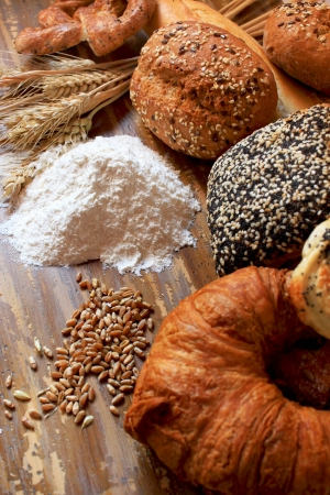 assortment of baked bread, with seeds or simple and pretzels photo