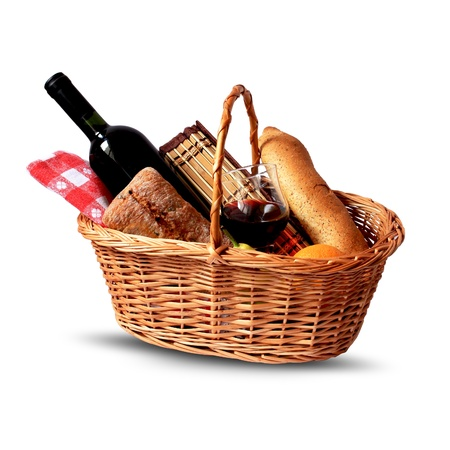 picnic blanket: basket for picnic with wine, bread, fruits and picnic blanket