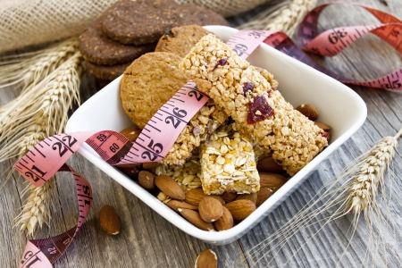 Muesli bars and almonds,diet concept photo