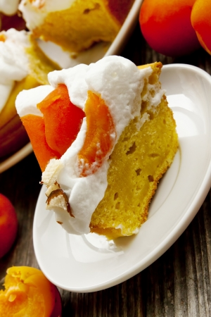 Apricot Tart with Whipped Cream and Flaked Almonds photo