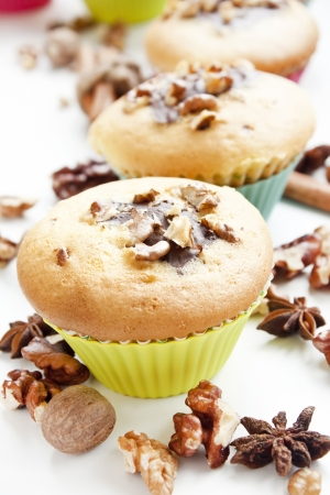 muffins with chocolate and walnuts placed in colorful muffin forms photo