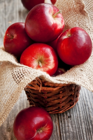 apple red: Red Juicy Apples Placed in a Basket Stock Photo