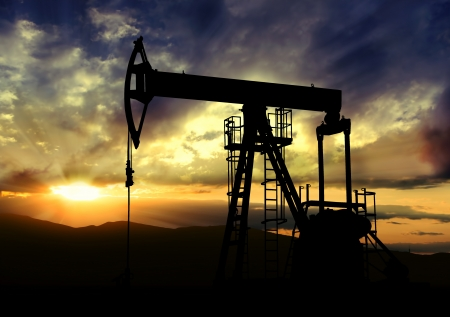 Oil pump jack.Oil industry equipment on sunset background Standard-Bild