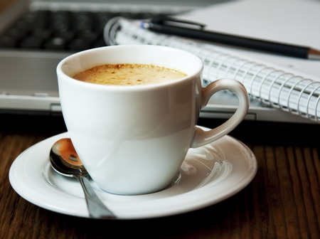 brewed: Cup of Cappuccino Coffee at Office.Coffee Break