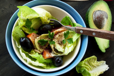 Fresh Avocado Salad with Flax, Pine and Sesame Seeds, Lettuce, Olives and Parsley Leaves photo