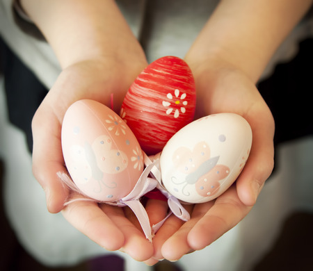 Child Hands Holding Colorful Easter Eggs , Protection Hands Symbol photo