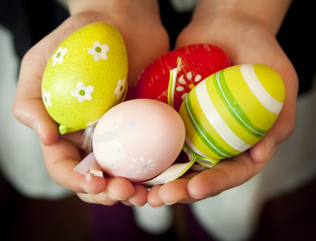 child protection: Child Hands Holding Colorful Easter Eggs , Protection Hands Symbol