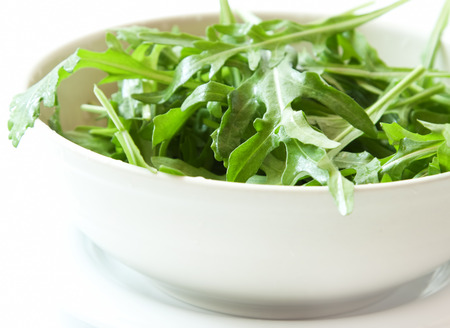 Fresh Arugula Salad in a Bowl, Healthy and Fresh Salad photo