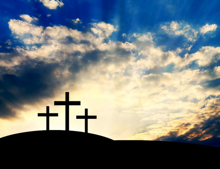 Christian Crosses on a Hill on Sunset Background