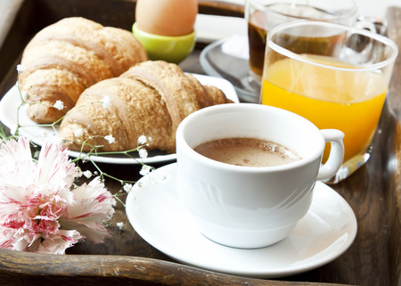 traditionally french: Fresh French Breakfast with Croissants and Coffee, Orange Juice and Flowers