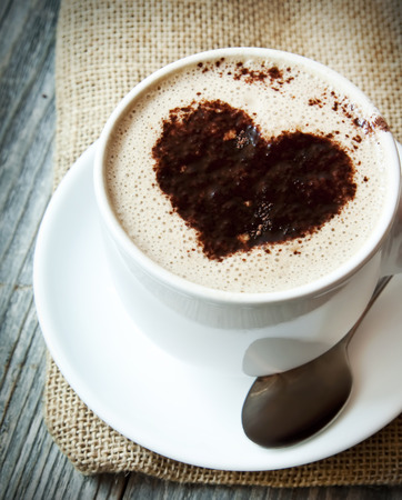 Heart Shape On Cappuccino Cup ,Love Concept photo