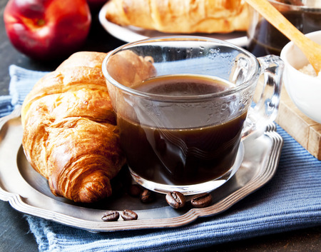 traditionally french: French Breakfast with Coffee Cup and Croissants