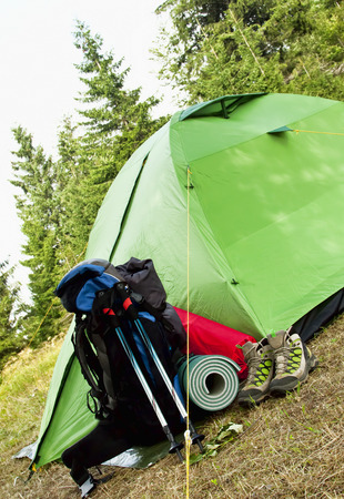 sleeping pad: Mountain Camping Equipment with a Tent,Boots, Backpack, Trekking Poles and Sleeping Pad Stock Photo