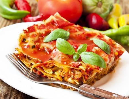Healthy Vegetarian Lasagna,Fresh Italian Recipe with Basil Leaves Imagens