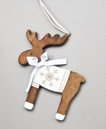 Vintage Wooden Reindeer Christmas Decoration on Grey Background photo