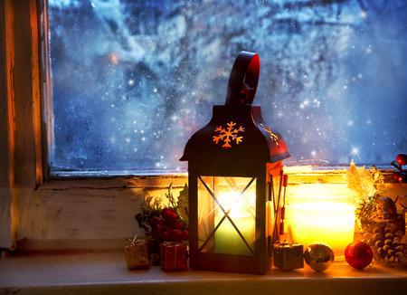 Winter Magic with Warm Lantern on Frozen Window, Cozy Setting