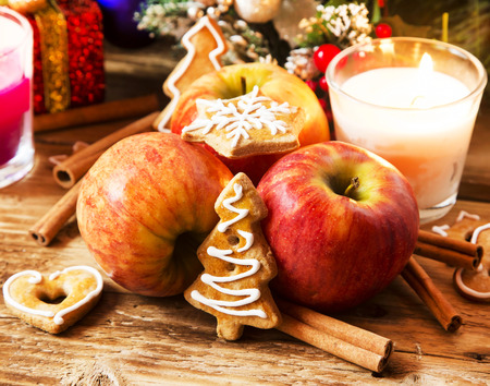 Apples with Spices and Gingerbread on Festive Christmas Decorations photo