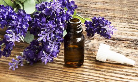 Lavender Essential Oil Bottle on Wooden Background