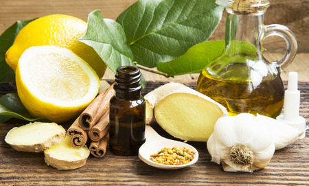 Alternative Medicine with Lemon,Pollen,Cinnamon , Ginger and Garlic Stock Photo