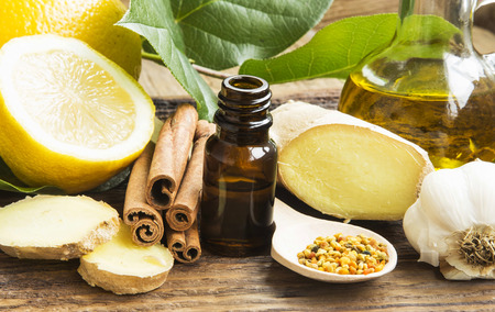 alternative therapies: Alternative Medicine with Lemon Oil,Pollen,Cinnamon , Ginger and Garlic