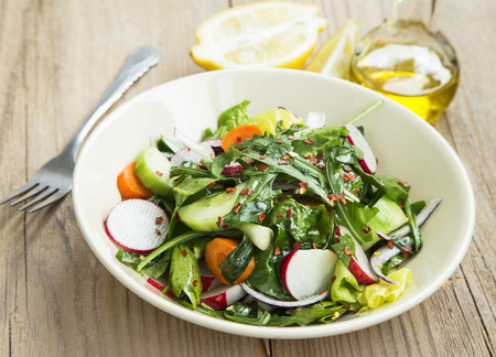 'baby spinach': Fresh Spring Vegetable Healthy Salad with Baby Spinach,Rucola,Cucumber,Onion, Carrot and Chilli Flakes