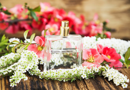 perfume: Flower Perfume in Transparent Bottle with Spring Blossom