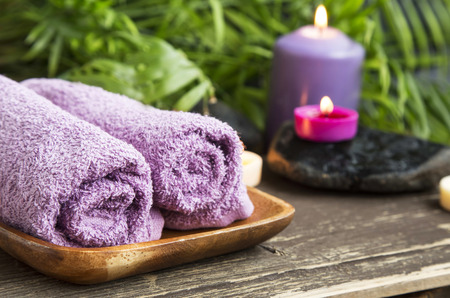 Spa Cotton Towels on Wellness Background with Scent Candles Burning Imagens