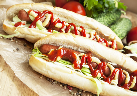 hot dog: Hot-Dog Meal.Sausages with Bread Buns,Lettuce, Mustard and Ketchup Sauces Stock Photo