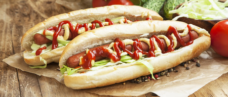 Hot-Dog Meal.Sausages with Bread Buns,Lettuce, Mustard and Ketchup Sauces Imagens