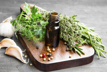 Herbs Oil Bottle with Garlic and Herbs, Alternative Medicine for Immune System Support