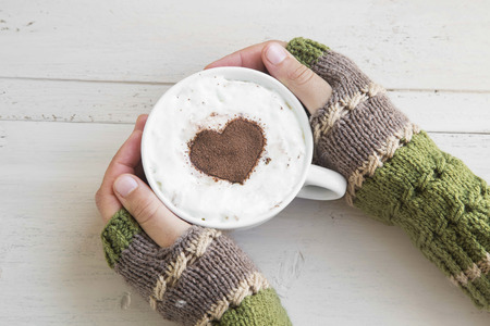 Holding Coffee Latte Cup with Cocoa Shape and Cozy Wool Hands Warmers
