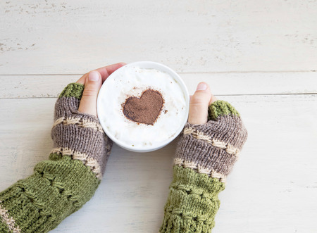 warmers: Holding Coffee Latte Cup with Cocoa Shape and Cozy Wool Hands Warmers