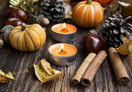 Fall Decoration with Pumpkins, Leaves,Candles, Cinnamon Sticks ,Chestnuts and Acorns Stock Photo
