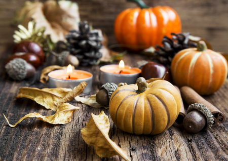 food on table: Pumpkins Decoration with Candles, Leaves, Acorns.Thanksgiving,Halloween and Autumn Concept Stock Photo