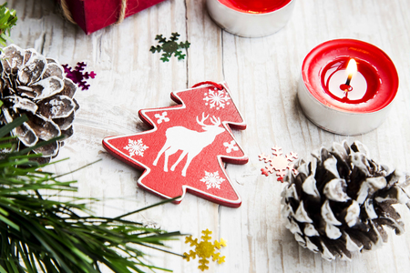 wooden reindeer: Wooden Reindeer Christmas Decoration with Ornaments and Burning Candle Stock Photo