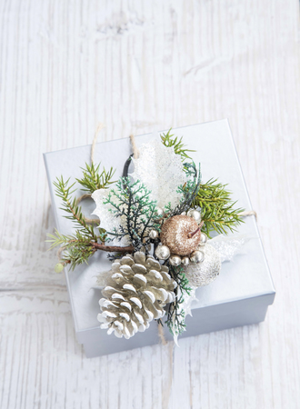 ornated: Silver Christmas Present Ornated with Pine Cone and Fir Tree Archivio Fotografico