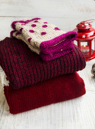 warmers: Cozy Fluffy Woolen Sweaters and Knitted Hand Warmers  for Winter Time with Christmas Lantern in the Background