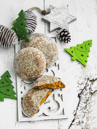 christmas food: Gingerbread Cookies with Christmas Ornaments on Painted Wood Stock Photo